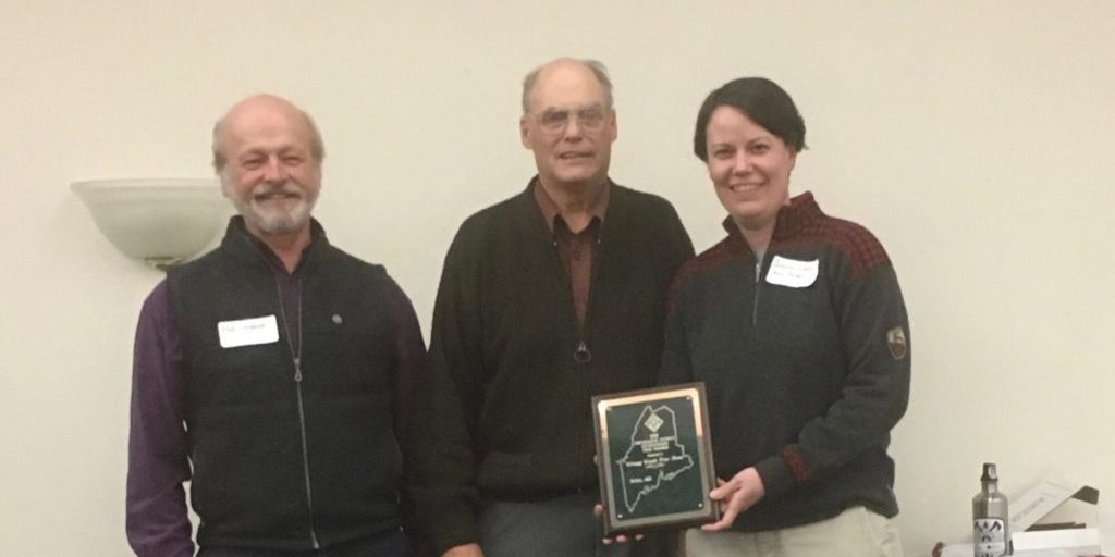 Bob and Jessica receiving the 2018 Piscataquis County Tree Farm of the Year Award from Doug Denico, the State Forester for the State of Maine.  Source: Jessica E. Leahy, Ph.D.